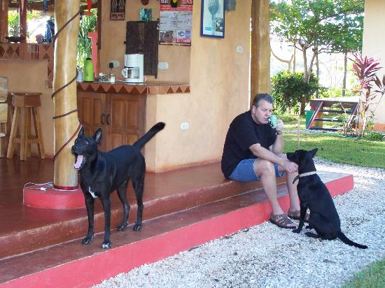 Fidelito Ranch & Lodge: Joe enjoying his coffee with Judy and Fido playing around.