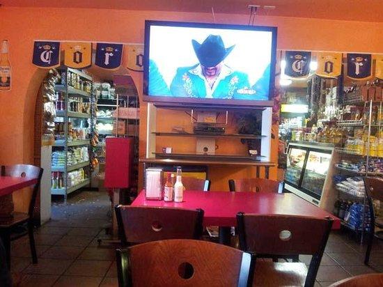 Tortilleria La Rancherita: View from restaurant toward grocery and flat screen.