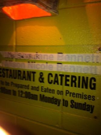 Casmar Restaurant and Bar: masking tape used to cover previous owners names. says alot about the restaurant