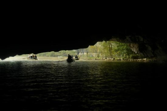 Hoa Lu - Tam Coc Day Tour: soon going to exit the naturally carved tunnel during the boat ride..