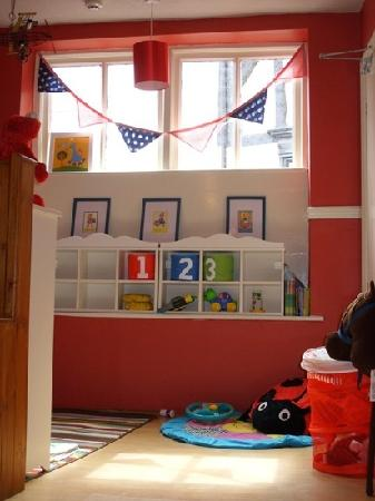 Sipping Happily: Kids area at the back of the cafe..