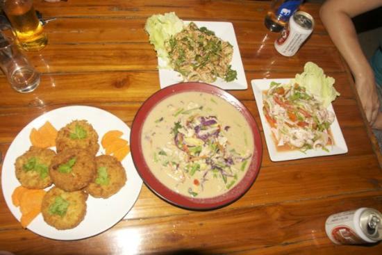 Blue Beach Restaurant: Another great meal with friends at Blue Beach. (Pork cakes are on the left.)