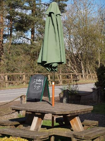 The Strathardle Inn: One of the numerous tables and benches outside the Inn.