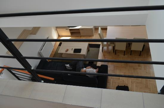 Gozsdu Court Aparthotel: View of the living area from upstairs.