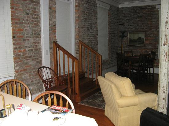 Consulate Suites: Exit to outside private balcony - note the original exterior brick wall