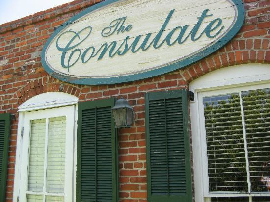 Consulate Suites: Name board on rear of property