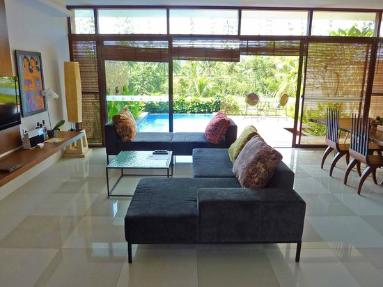 Ubud Green: Bumi 2 living/dining/kitchen with deck and pool in background