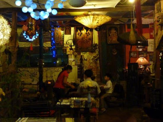 Champor-Champor Restaurant & Bar: The restaurant is a garden with lots of plants and wooden masks on the walls, floor, etc.