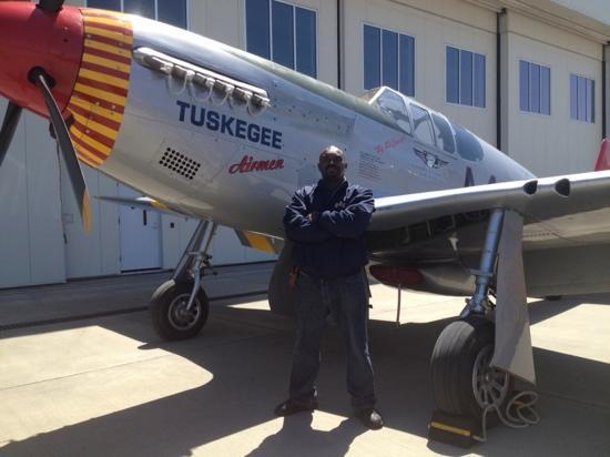 Carolinas Aviation Museum: hubby posing with red tail plane