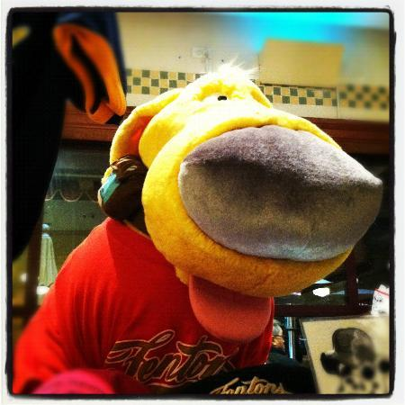 Dug, the dog from Up (catch the sign near the end of the movie), in Fenton's gear.
