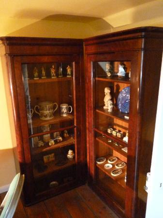 Charles Dickens' Birthplace: Display cabinet in attic