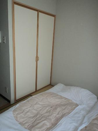 Family Inn Saiko: closet for beds - and other things :)