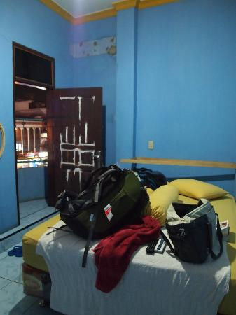 Pondok Wisata Angel: Tiny basic room, with a balcony overylooking a main drag/busy street below.