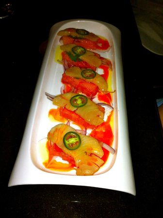 Sublime: Hamachi Crudo with jalapeño served over a Watermelon Slice