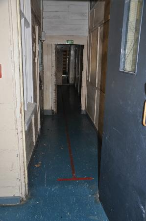 Napier Prison Tours: The hallway damaged by the earthquake