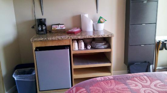 Shoreline Cottages: microwave and refrigerator along with plates and utensils