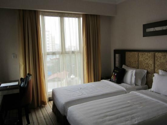 Silk Path Hotel: One of the 2 windows - note the natural light coming through the curtains.