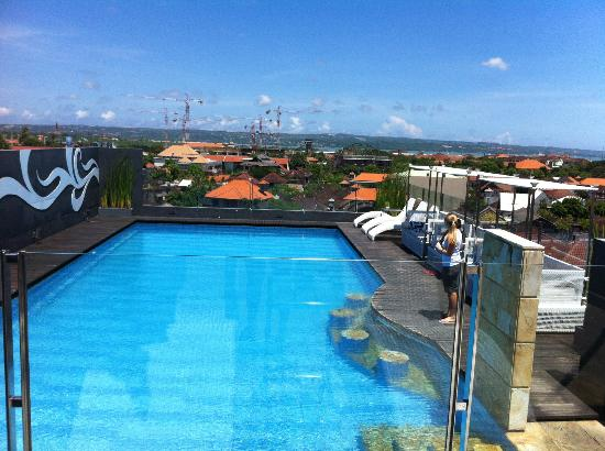 J Boutique Hotel: Pool and view towards the airport