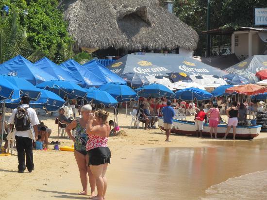 Playas Caleta y Caletilla: Restaurante Titos in the background.