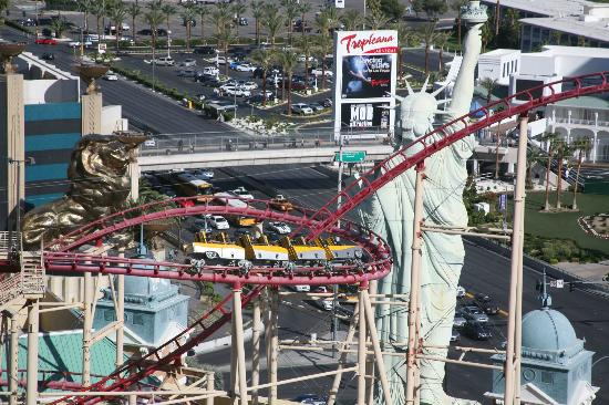 """The Big Apple Coaster Virtual Reality Experience - $ Chase aliens high above the Las Vegas Strip! All passengers must be at least 54"""" to ride and a minimum of 13 years old to ride with virtual reality."""