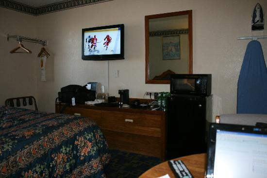 Super 8 Carlsbad: L-R HD TV, My crap,Microwave on top of fridge, Iron and board.