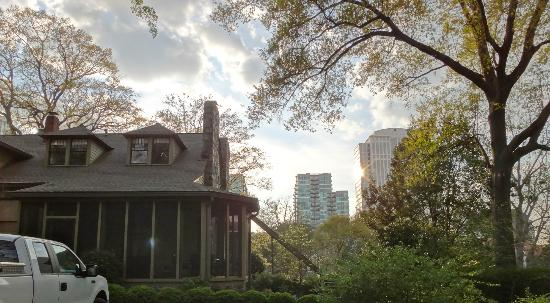 Stonehurst Place: View from backyard with house on left and the high-rises of Midtown in the background.