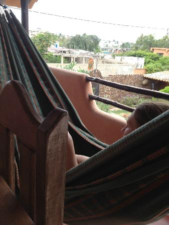 Posada Margarita: My friend is relaxing in a hammock
