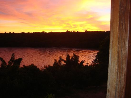 Cabier Ocean Lodge: The sun setting over the bay, viewed from the studio veranda