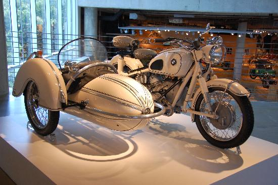 vintage bmw motorcycle with side car in a rare white color