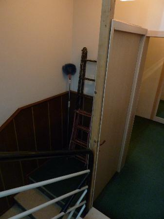 Seven Hotel: Odd door on stairway.
