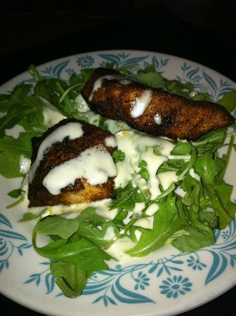 Geri's : Swordfish over arugula with shaved cheese.