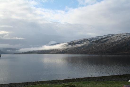 Point Cottage B&B: Snow on the hills over Loch Broom viewed from the room.