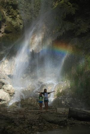 Oslob, Philippines: When sunlight strikes the falling water, a very visible rainbow would appear at it's base.