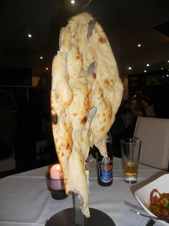 Raja of Cheadle Indian Restaurant & Take Away: A Naan on a tree stand, huge and only £2.50
