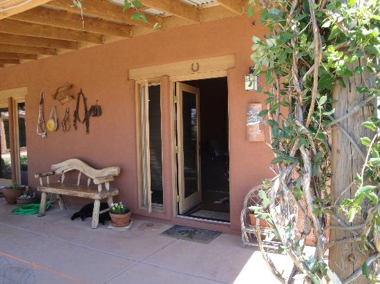 La Hacienda de Sonoita: View of the front door of the Grand Canyon room, that's Jazzie haning out sleeping under the ben
