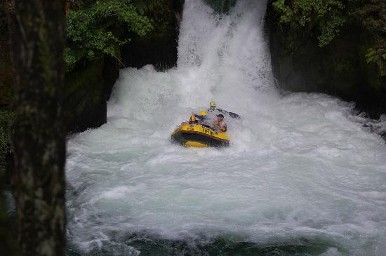 Rotorua Rafting: Exiting the 7m waterfall, with me hanging out the raft
