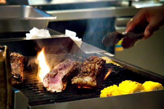 Red Snapper Restaurant & Bar: Hot Cooking! Premium Beef on the Grill