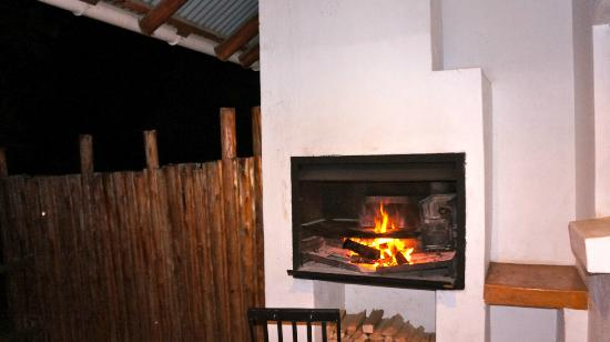 Tsanana Log Cabins & Mulberry Lane Suites: a fireplace in each room