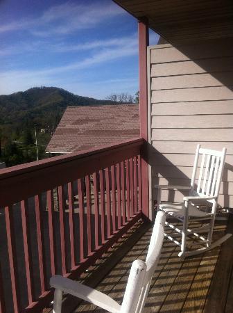 Super 6 - Waynesville: White rocking chairs