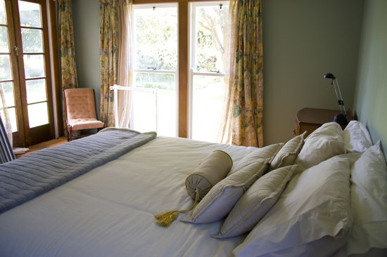 The Clearview Homestead: The master bedroom, french doors that open to a sun drenched porch