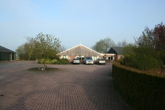 Haarle, The Netherlands: View of parking entrance ... front doors are just around to the right of the vehicles