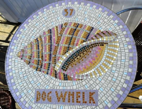 The Boardwalk Restaurant: One of our beautiful mosaic tables featuring North Sea fish and shells