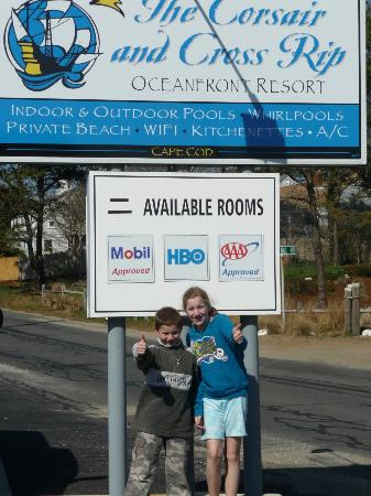 Corsair and Cross Rip Oceanfront: In front of the hotel sign...2 thumbs up