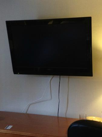 Park Town Hotel: close up of loose wires from flat screen tv