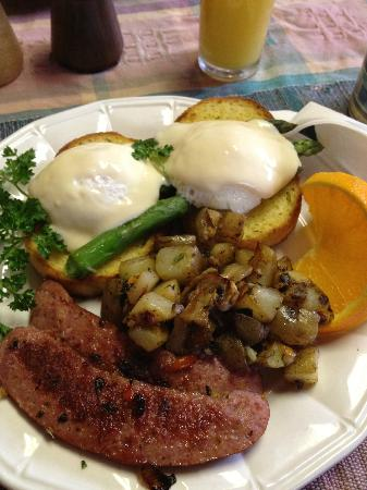 A Moose in the Garden Bed & Breakfast: Poached eggs, reindeer sausage, asparagus, potatoes with mushrooms and a slice of orange, BOOM!