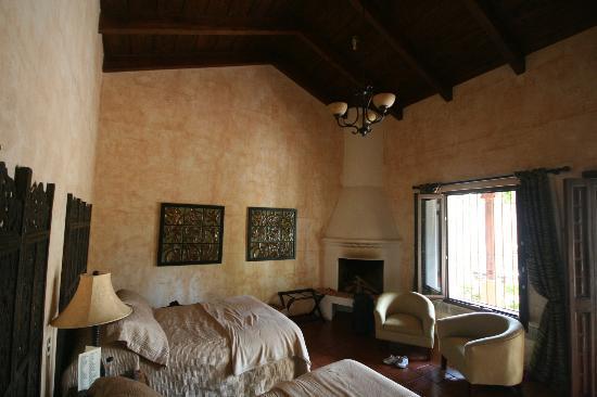 Hotel Cirilo: Room 4 interior.  Fireplace in corner.