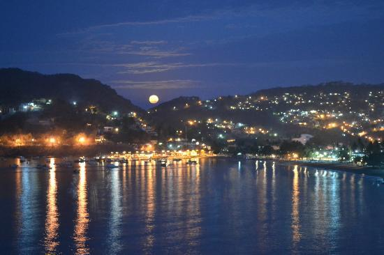 Hotel Irma: The moon setting across the bay