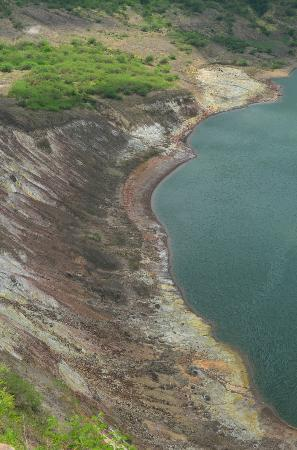 Taal Volcano: sulphur deposition inside crater lake and steam holes
