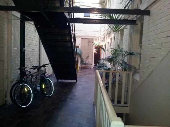 The Metropole Guesthouse: The courtyard with our bikes