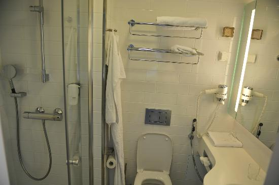 Scandic Julia: The bathroom seen from the door. Shower stall to the left, sink to the right.